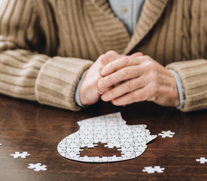 Man with brain jigsaw